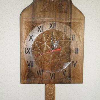 Reloj de péndulo en nogal
