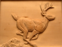 Detalle relieve ciervo en tilo